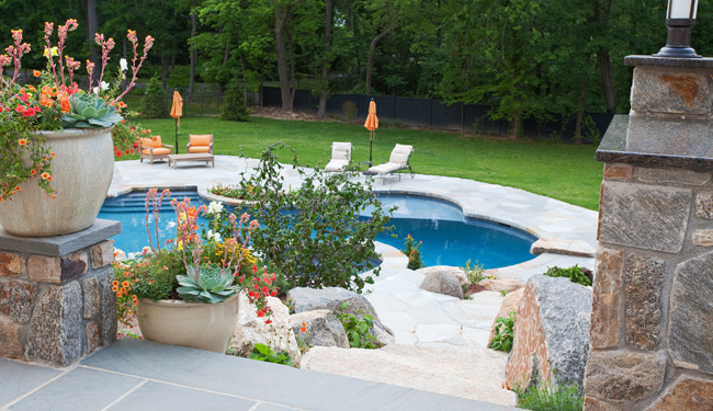 Landscaped pool at Milton built shingle style colonial